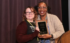 Nerissa Ediza, adviser of the Bronco Blaze newspaper at Parkrose High School, accepts award for the 2015 Mary Hartman Oregon Journalism Teacher of the Year award from former NWSP Executive Director, Dr. Karla Kennedy.
