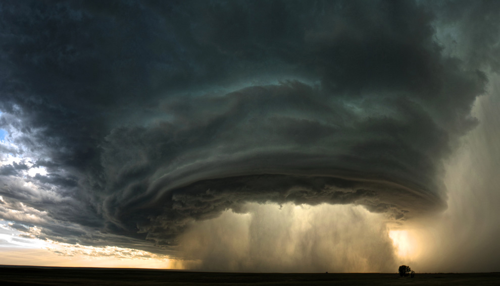 A supercell thunderstorm rolls across the Montana prairie at sunset. (Photo and caption by Sean Heavey)