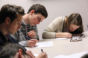 Students work on submissions for the write-off competition, which covered a variety of topics.