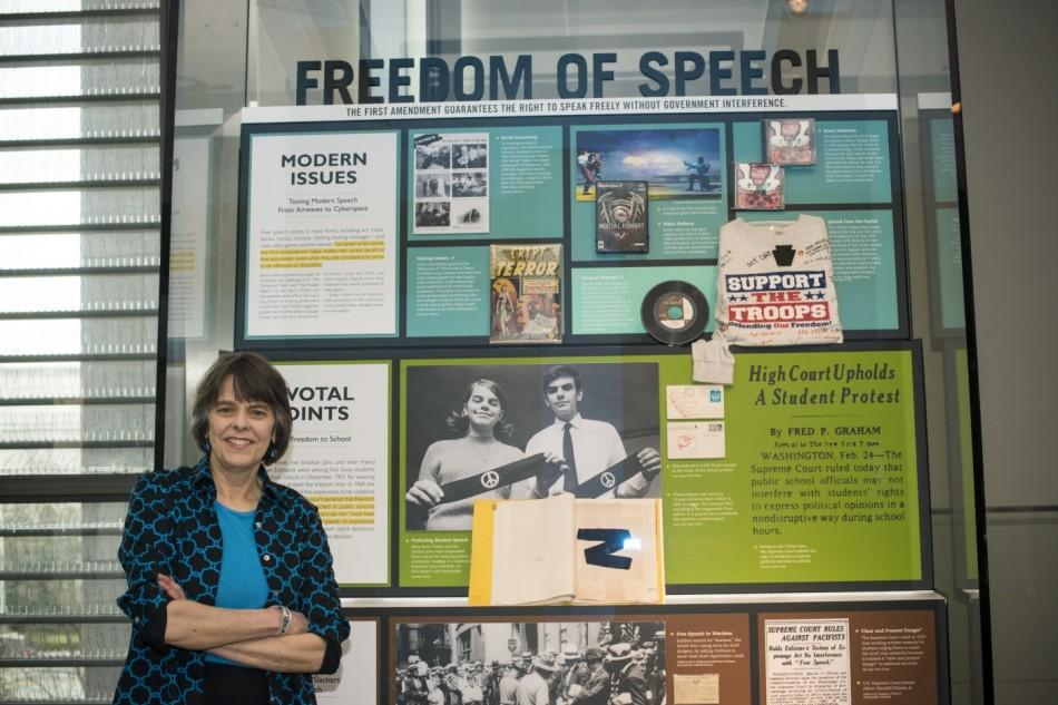 Mary Beth Tinker at the Newseum in Washington, D.C. in front of the permanent exhibit commemorating the Tinker v. Des Moines case. She is pictured with her brother John holding the black armbands they wore in silent protest of the Vietnam War when she was a 13-year-old junior high school student. She talks with journalism students today in Portland at an event hosted by Northwest Scholastic Press.