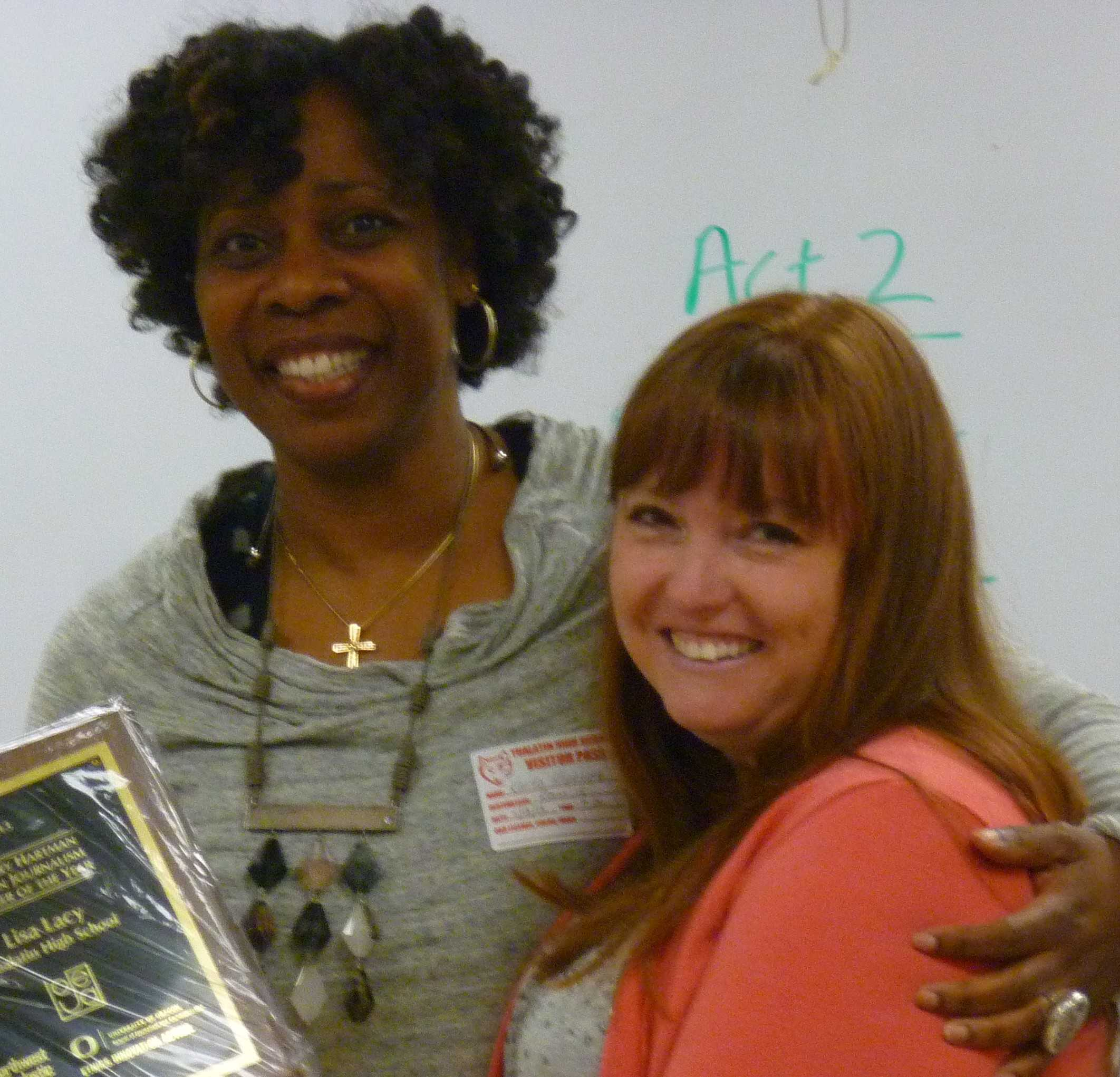 Lisa Lacey, the journalism teacher at Tualatin H.S., receives the 2013 Mary Hartman Oregon Journalism Teacher Of The Year Award from Northwest Scholastic Press Association Executive Director Karla Kennedy. (Photo by Rob Melton)